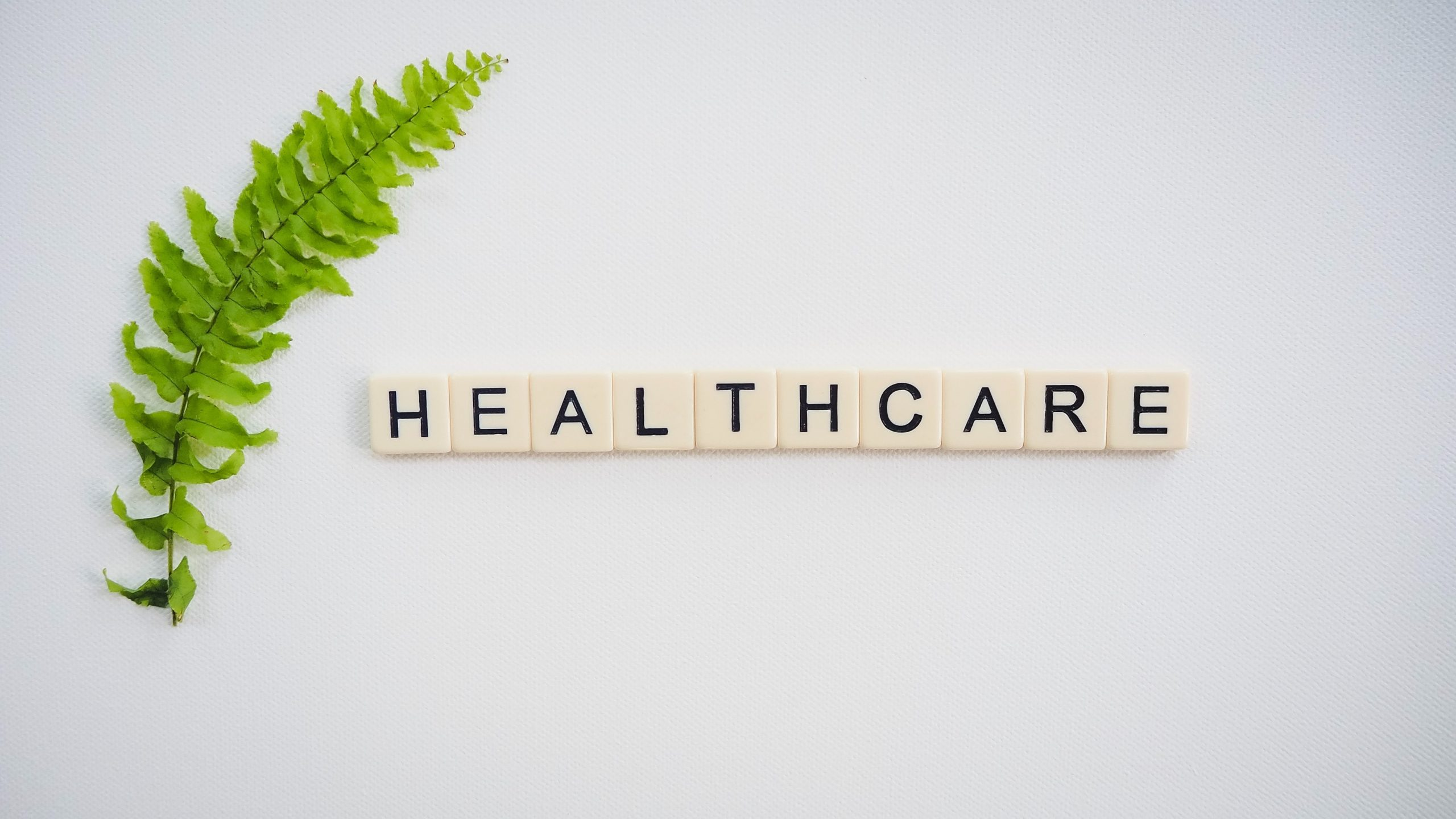 Healthcare spelled out with scrabble pieces